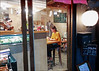 Another Night of Eating Alone - Asakusa (Tokyo), Japan (TravelsWithDan) Tags: youngwoman night restaurant candid streetphotography throughthewindow alone eating asakusa japan canong9x ngc