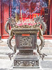 IMG_5088 Burning incense sticks, Buddhist Temple, Hue, Vietnam (briancarrollphotos) Tags: buddhisttemple huevietnam hue vietnam dragons templedragons
