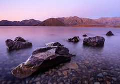 A Jagged 6 (ajecaldwell11) Tags: rock ankh purple water southisland lake boulders sea longexposure blue beach newzealand otago heron sky rocks waves caldwell tide lakeheron