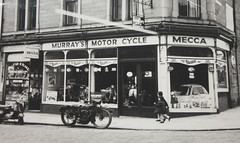 Doug Murray's Motor Cycle Mecca Dundee. (Yesteryear-Automotive) Tags: motor cycle mecca motorcycle scooter motorscooter motorbike showroom garage shop agency microcar micro car bubblecar bubble doug murrays 169 hawkhill dundee hunslet scootercar scotland indian fk486 1960s vespa agent