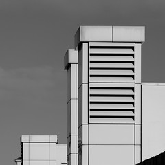 Strutture bianche. White structures B&W (sandroraffini) Tags: people mover white structures parallelepipedi bw canon eos80d 70200 geometry minimalismo minimalist architecture architettura industriale industrial bologna bianche strutture linee semplici solidi