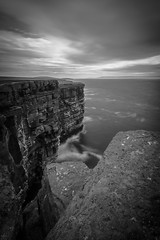 Mind the Gap (MBDGE >1.4 Million Views) Tags: orkney westray mono blackandwhite cliffs canon canon70d clouds cliff clifftop cloud edge south nd neutraldensity stop mindthegap mind gao gap tube warning drop