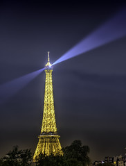 Eiffel Tower at MIdnight (Charles Patrick Ewing) Tags: eiffel tower midnight night clouds light lights landscape landscapes outdoor nature natural building architecture monument monuments paris france french blue sky tree trees house houses new all everything lowlight yellow gold reflection color colorful colours colour colors colourful fave faves