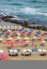 Beach in Tel Aviv (Monica@Boston) Tags: blue wave water ocean people umbrella summer israel telaviv beach