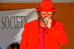 Harp Man (thomasgorman1) Tags: red colors colorized musician harp harmonica man player suit baja concert jam gig outdoors stage processed treated effects streetphotos streetshots street sunglasses