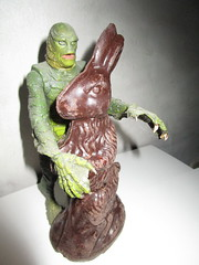 Easter Creature and Chocolate Rabbit 9083 (Brechtbug) Tags: easter creature chocolate bunny rabbit 2018 universal pictures studio black lagoon monsters new york city undead zombie cadaver horror terror halloween fright toy toys moody shadow shadows face portrait 1954 movie film hollywood fish man gill gillman collectable collectible type lite light holiday gloomy goth gothic action figure chocolates eeeaster april fools green 04012018