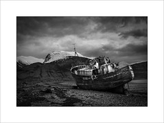 The Corpach Wreck (tkimages2011) Tags: boat ship wreck water sky beach mv dayspring corpach pebbles outside outdoor fortwilliam scotland mono monochrome decay trawler bennevis mountain snow creative contemporary grounded aground canon 5d4 highlands shipwreck