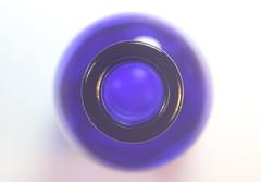 Dreams of blue circles (Snorkle-suz) Tags: macromondays circles blue glass bottle macro closeup newzealand aotearoa nz indoors insidemyhouse stilllife tabletop canoneos600d dof canoneosrebelt3i canoneoskissx5 helios44mf258mmlens helios helios44m helios44mlens