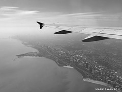 Approaching Chicago (mswan777) Tags: shore coast wing pylon chicago illinois downtown building highway land travel monochrome black white apple iphoneography iphone mobile cloud haze