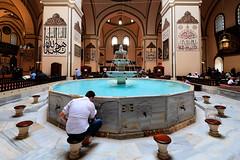 A man washing for prayer in ablution fountain inside the Grand Mosque of Bursa, Bursa, Turkey (CamelKW) Tags: 2018 bursa turkey