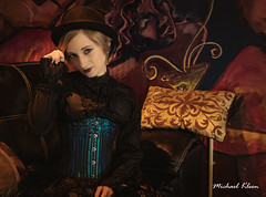 Victorian Ziv at the Paddock Club 1 (makleen) Tags: ziv eiraangelic victorian steampunk parlor paddockclub black dark goth corset pale watertown jeffersoncounty newyork vintage retro cosplay bowlerhat hat costume portrait couch