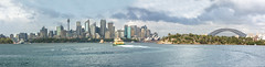 Sydney Skyline (Jonathan⦿) Tags: sydney skyline cityscape city operahouse harbourbridge panorama panoramic opera house bridge harbour harbor australia australian ferry boat water landscape architectural architecture attraction bay buildings bright sunny bradleyshead colorful travel tourism vivid blue business capital cbd clear clouds district downtown financial high wide landmark newsouthwales nsw sky skyscrapers trees view