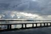 Water and light (1/2) (danielhast) Tags: madison wisconsin lakemendota lake mendota water sky clouds boat sailboat pier people reflection