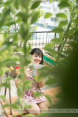Smile over leave (Hosting and Web Development) Tags: smile young yard eyes eye green garden roof face female femininity hair hand happy vertical vietnam body beautiful book leg leaf colonnade column clothing casual one outdoor portrait woman girl plant person sit look