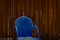 Blue Chair (lorinleecary) Tags: chair cambria blue californiacentralcoast woodfence lines curves fence