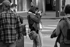 People on Market St 18 (TheseusPhoto) Tags: blancoynegro blackandwhite monochrome noir people citylife city streetphotography street sanfrancisco marketstreet candids candid girl woman photographer camera