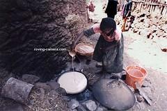 Woman Making Injera in Lalibela, Ethiopia (deemixx) Tags: ethiopia africa lalibela injera ethiopianfood ethiopiancooking