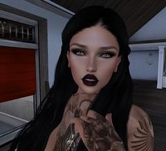 Close. (Hanzworld) Tags: black hair tattoos tanned green eyes makeup smudge smokey freckles teeth peircings