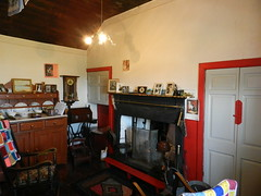 Mary Ann's Cottage Interior, Dunnet, Caithness, May 2018 (allanmaciver) Tags: mary ann cottage interior patchwork quilt open fire wedding album family portraits clock door red style furniture rocking chair cosy front room plates allanmaciver