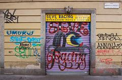IMGP9355 Steve Racing (Claudio e Lucia Images around the world) Tags: steve racing angelodellapergola milano shop window gate door painted streetart murales graffiti colored sigma sigma1020 pentax pentaxk3ii