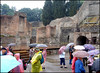 Umbrellas in Pompeii. (Country Girl 76) Tags: pompeii italy archaeological site ancient history raining umbrellas people walls trees roman ruins architecture puddles wet