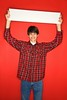 Stock Images (perfectionistreviews) Tags: color caucasian male teen banner vertical lookingatviewer indoors red blank concept portrait person 1315years onepersononly halflength studioshot posed eyecontact looking teenageboy promote advertise message blanksign holding sign photograph conceptual signsandsymbols