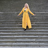 Dancing on the steps (piotr_szymanek) Tags: kasia kasiak portrait outdoor woman young dress yellow steps citadel smile transparent eyesoncamera 1k 20f 5k 10k