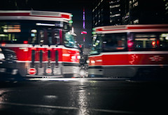 Head To Head (Paul Flynn (Toronto)) Tags: toronto city dundas streetcar ttc cn tower transit transportation night lights intersection street road public torontotransitcommission commission