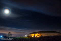 Newgrange and the moon (mythicalireland) Tags: newgrange monument megalithic neolithic passagetomb mound cairn night sky full moon halo clouds stars astronomy astrophotography landscape tree lights