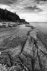 Into the deep (Mark Heine Photos) Tags: cliffs bw niagaraescarpment boulders rocks brucetrail beach greatlakes blackandwhite brucepeninsula escarpment sky markheine ontario georgianbay halfwaylogdump canada