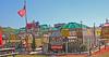 Garys Nut House, Kirby Family Farm, Williston, Florida (2 of 3) (gg1electrice60) Tags: kirbyfamilyfarm amusements amusementsfordisadvantagedchildren amusementsforcriticallyillchildren openingin2019 19650ne30thstreet 19650northeast30thst 1965030thstreet 19650nethirtiethst florida fl unitedstates usa us america specialevents trainrides trains focusonrailroadagriculturalhistory americanflag garysnuthouse carnivalrides umbrellas signs picnictables benches snacks nuts fastfood lattice fence picketfence splitrailfence garbagecans trashcans lights williston