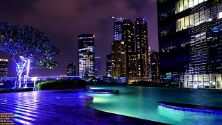Infinity pool and the city skyline at dusk..