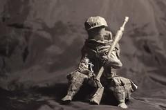 Worn out trooper (Nikita Vasiliev) Tags: origami origamiart paper paperart soldier trooper war rifle gun helmet smoke letter cigarette scarf backpack reading