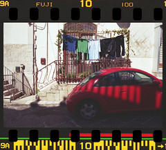 NCP_012 (nocrop.project) Tags: ncp nocropproject filmphotography filmisnotdead grainisgood istillshootfilm 35mmfilm analogue photography darkroom neorealism streetphotography ordinarylife fujicolor 100 canosa puglia italy color film grain is good red car rural pentax k1000 expired selfdeveloped tetenal c41 old city