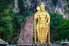 Batu Caves statue and entrance near Kuala Lumpur, Malaysia (Patrick Foto ;)) Tags: ancient antique asia attraction batu buddha carnival cave cavern celebration cliff crowd culture deity destination famous figure god gold golden guardian hill hindu hinduism iconic indian kuala landmark limestone lord lumpur malaysia mountain murugan praying protector religion religious sculpture shiva southeast staircase stairs statue temple tourism travel traveler vacation worship batucaves selangor my