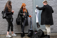 Clothes Swap (Silver Machine) Tags: london shoreditch streetphotography street candid girl boy redhair pvc clothes standing outdoor people groupofpeople fujifilm fujifilmxt10 fujinonxf35mmf2rwr