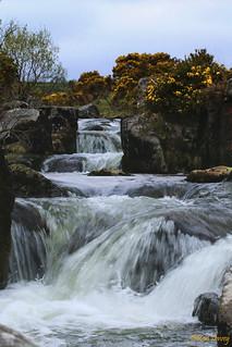 Cascading water upstream near Caddover Bridge, Dartmoor, UK.