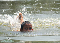 Swimming (Suman Kalyan Biswas) Tags: pond ruralphoto rurallife village ruralpeople portrait water splash refresh outdoor refreshing expression excitement enjoyment joy child childhood kidding nakashipara boyhood fun happy playingwithwater play bathing ruralindia ruralchildren ruralculture indianvillage swimming bethuadahari westbengal india