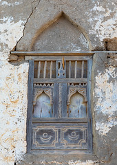 Wooden carved window of an abandoned house, Dhofar Governorate, Mirbat, Oman (Eric Lafforgue) Tags: abandoned arabia arabianpeninsula arabic arabicarchitecture arabicstyle architecture buildingexterior carved carvedwindow carvingcraftproduct colorimage day decrepit dhofar dhufar exteriorview facade ghosttown gulfcountries habitation history house houseexterior mirbat moscha nopeople old oldhouse oman oman18200 outdoors sultanate thepast traveldestination traveldestinations vertical weathered window woodenwindow dhofargovernorate om