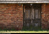 20170630_26 Wooden door in red brick wall | Auschwitz concentration camp, Poland (ratexla) Tags: ratexlasinterrailtrip2017 interrail auschwitz 30jun2017 2017 canonpowershotsx50hs interrailing eurail eurailing tågluff tågluffa tågluffning travel travelling traveling journey epic europe earth tellus photophotospicturepicturesimageimagesfotofotonbildbilder wanderlust vacation holiday semester trip backpacking tågresatågresor resaresor europaeuropean sommar summer ontheroad oświęcim poland polska auschwitzconcentrationcamp concentrationcamp ww2 secondworldwar war nazism racism bigotry history violence museum theholocaust förintelsen koncentrationsläger door doors dörr dörrar wood wooden trädörr auschwitziibirkenau brick bricks tegel building buildings hus house houses old decay