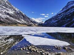 frozen lake (ekelly80) Tags: norway april2018 spring møreogromsdal eidsal lake frozen ice melting mountains snow reflection drive water rocks rocky blue sky springday beautifulday