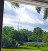 Looking Out the Window at the Clouds (soniaadammurray - On & Off) Tags: iphone exterior window sky clouds trees creek water grass platform eagles stadiumlight nature reflections shadows sunlight garden martesdenubes martedidinuvole nicewonderfultuesdayclouds nest