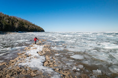 Boy walks along shore of frozen lake in Ontario wilderness (blurMEDIA Stock) Tags: brucepeninsula canada earth georgianbay ontario child childhood climate climatechange cold conservation environment exploring fragile freezing frozen globalwarming ice icy lake lakeshore landscape learning melt melting outdoor phasechange planet preservation shoreline solitary solitude spring springthaw stewardship thaw warming water wilderness winter winterjacket