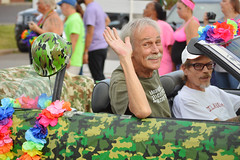 Waving from the camouflage car (radargeek) Tags: june 2017 pride okcpride gayprideparade parade okc oklahomacity oklahoma glasses lei flower rainbow army helmet waving