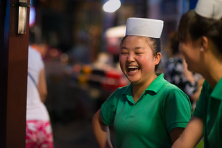 A chinese woman laughing in the Muslim Quarter of Xi'An, China