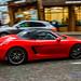 Porsche 718 Boxster & Porsche Cayenne Pass on Wet Vancouver Street