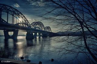 Sun Setting Behind The Bridge
