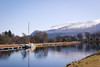 Moored up along the Caledonian Canal. (ho_hokus) Tags: 2018 caledoniancanal escocia lochlinnhe nikond80 schottland scotland scozia tamron18270mmlens unitedkingdom canal écosse peaks snow water boat