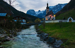 Spring evening in Ramsau, Berchtesgaden region (echumachenco) Tags: ramsau berchtesgadenerland berchtesgadeneralpen ramsauerache brook stream river water flow landscape outdoor church steeple stsebastian village house building architecture mountain mountainside mountains reiteralpe mühlsturzhorn ramsauerdolomiten sky cloud evening spring april bavaria bayern germany deutschland nikond3100 grass stone rock snow peak