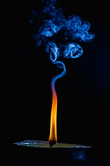 Magic smoke 6 (gerlos) Tags: fumo flame stilllifephotography electricblue computerwallpaper smoke specialeffects flash fuoco darkness anyvision speedlights labels fire fiamma english canon